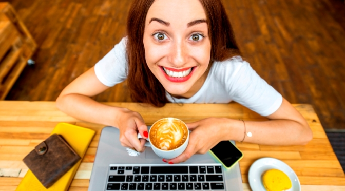 Girl with laptop and manic grin